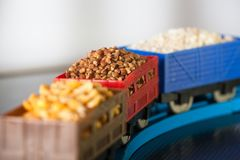 Wagons with grain of buckwheat, rice and peas. Grain Cultures. Wagons with grain of peas, rice and buckwheat. Grain Cultures. Selective focus royalty free stock image
