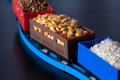 Wagons with grain of peas, rice and buckwheat. Grain Cultures. Selective focus royalty free stock images