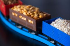 Wagons with grain of rice, peas and buckwheat. Grain Cultures. Selective focus royalty free stock photography