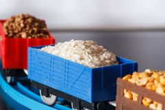 Wagons with grain of rice, peas and buckwheat. Grain Cultures. Selective focus stock image