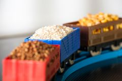 Wagons with grain of rice, peas and buckwheat. Grain Cultures. Selective focus stock images