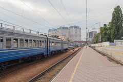 Wagons in a train station and an empty platform Royalty Free Stock Images