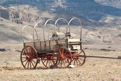 Wagons West. A Conestoga wagon sits beneath a Wyoming mountain stock images