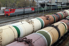 Wagons With Coal And Oil Tankers Stand On Railway Tracks. Stock Images