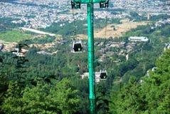 Wagony kolei linowej niosą ludzi szczyt góra Cangshan Obraz Royalty Free