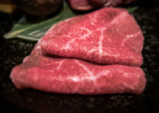 Wagyu beef slices on plate. Thin finely sliced raw wagyu beef served on plate. This restaurant is in Kyoto, Japan Stock Photos