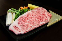 Wagyu beef striploin steak. Piece of Wagyu beef striploin steak Royalty Free Stock Image