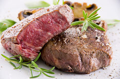 Wagyu Steak with Herbs. As closeup on a white board Stock Image