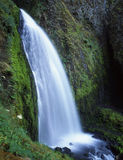 Wahkenna Falls. A waterfall by moss covered rocks Stock Photo