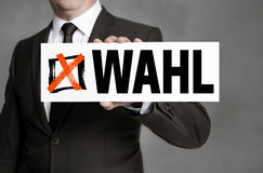 Wahl in german Election sign is held by businessman.  Royalty Free Stock Photography
