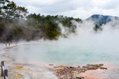 Wai-O-Tapu Thermal Wonderland New Zealand. View of colorful steaming volcanic Champagne pool in geothermal Wai-O-Tapu wonderland in Rotorua, North Island, New stock photos