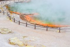 Wai-O-Tapu Thermal Wonderland New Zealand. View of colorful steaming volcanic Champagne pool in geothermal Wai-O-Tapu wonderland in Rotorua, North Island, New royalty free stock image