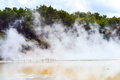 Wai-O-Tapu Thermal Wonderland New Zealand. View of colorful steaming volcanic Champagne pool in geothermal Wai-O-Tapu wonderland in Rotorua, North Island, New stock image