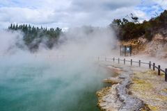 Wai-O-Tapu Thermal Wonderland New Zealand. View of colorful steaming volcanic Champagne pool in geothermal Wai-O-Tapu wonderland in Rotorua, North Island, New royalty free stock photos