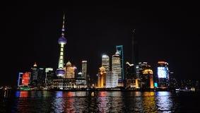 Wai Tan at night. Shanghai, CHINA - JANUARY 4, 2014 : Wai Tan Putong Night view Shanghai China Sea Road Neon Streetlight Rows of buildings Stock Photo