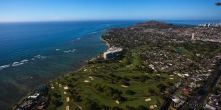 Beautiful aerial view of Diamond Crater and the Waialae golf course and Country Club Oahu, Hawaii.waii. Waialae Country Club is a private country club in stock photo