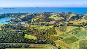 Aerial view on beautiful bay at sunny day with sandy beach and residential houses on the background. Waiheke Island, Auckland, New royalty free stock photography