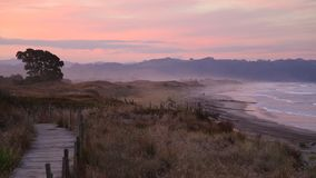 Sunset fog in Waihi Beach stock footage