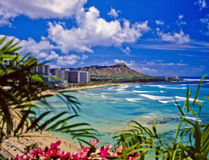 Waikiki beach and diamond head. The surf rolls in at waikiki beach and diamond head in Hawaii Royalty Free Stock Photo