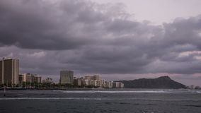 Waikiki Beach & Diamond Head Time Lapse Video. Waikiki Beach on the beautiful Hawaiian Island of Oahu. Time lapse video shows fast moving waves and clouds stock video footage