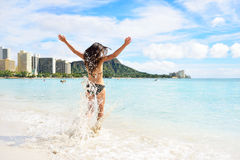 Waikiki beach fun - happy woman on Hawaii vacation Royalty Free Stock Photography