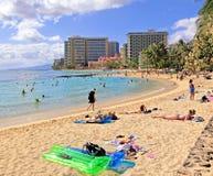 Waikiki Beach  Hawaii. People relax and enjoy the sun and ocean at Waikiki Beach,Honolulu, Hawaii Stock Images