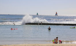 Waikiki Beach  Hawaii. People relax and enjoy the sun and ocean at Waikiki Beach,Honolulu, Hawaii Royalty Free Stock Photography