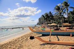 Waikiki Beach  Hawaii. People relax and enjoy the sun and ocean at Waikiki Beach,Honolulu, Hawaii. Outrigger canoe  in foreground Stock Photography