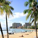 Waikiki Beach, Honolulu,  Hawaii. People relax in sun at Waikiki Beach,Honolulu, Hawaii Royalty Free Stock Image