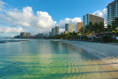 Waikiki beach morning. With blue sky and transparent clean water stock image
