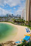Oahu Waikiki Beach near Hilton Hotel. Waikiki Beach near the Hilton Hotel on a sunny afternoon. The beach area crowds have been removed from the image for royalty free stock photo