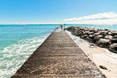 Waikiki beach pier in Honolulu, Hawaii Stock Images