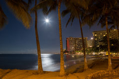 Waikiki beach resort full moon night Royalty Free Stock Photos