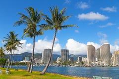 Waikiki beach resort and marina in Honolulu, Hawaii, USA. Scenic view of the Waikiki resort and marina with tall palms Stock Images
