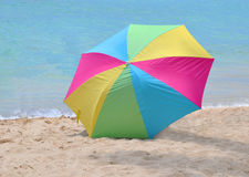 Waikiki Beach Umbrella. This is an image of a multicolored beach umbrella on Waikiki Beach in Honolulu, Hawaii Stock Photography