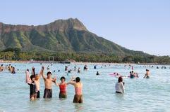 Waikiki Hawaii. Japanese tourists enjoying the beach at Waikiki Stock Images