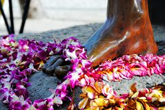 A close up of the foot of Duke Kahanamoku iconic statue. stock photos