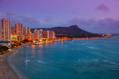 Waikiki skyline and shoreline. A dramatic view of Waikiki Beach, Hawaii at sunset with Diamond Head crater and hotels in background Stock Image