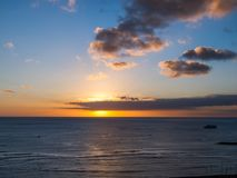 Waikiki Sunset. Sunset off of Waikiki with golden highlights reflected in the water Royalty Free Stock Photography