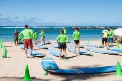 Waikiki surf lessons. Students observe native Hawaiian surf instructor teach the way of the surfboard on Waikiki beach, Hawaii Royalty Free Stock Photography