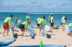 Waikiki surf lessons. Students observe native Hawaiian surf instructor teach the way of the surfboard on Waikiki beach, Hawaii Royalty Free Stock Images