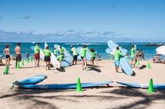 Waikiki surf lessons. Students observe native Hawaiian surf instructor teach the way of the surfboard on Waikiki beach, Hawaii Stock Images
