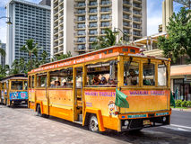 Waikiki Trolley. WAIKIKI, HAWAII - APRIL 29: Waikiki Trolley bus on Kalakaua avenue in Waikiki on April 29, 2014. The Waikiki Trolley bus is a popular shuttle Stock Image