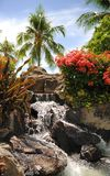 Waikiki Waterfall. This is an image of a fountain that designed to look like a small waterfall or a spring.  It is popular for visitors to stop and have their Royalty Free Stock Photography