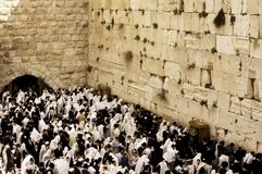 Wailing Wall in Jerusalem. A mass prayer and blessing for the Jewish people at the holy site of the Wailing Wall in east Jerusalem during Passover celebrations Royalty Free Stock Photo