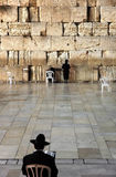 The Wailing Wall - Jerusalem. The Western or Wailing Wall in Old City of Jerusalem with two praying men. Israel, Middle East, Asia Royalty Free Stock Photo