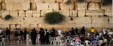 Wailing Wall in Jerusalem. Praying people near The Western Wall in Jerusalem, Israel. The Western Wall is the most sacred site in Judaism Stock Images