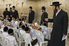 Wailing Wall Schoolboys. A teacher speaks to a group of schoolboys during a visit to the Western (Wailing) Wall in Jerusalem Royalty Free Stock Images