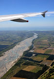 Waimakariri River Aerial, New Zealand. An aerial view of the braided Waimakariri River and the Canterbury Plains, New Zealand. In the background is the east cost Royalty Free Stock Photo