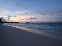 Waimanalo Beach looking towards Mokulua islands at dusk Royalty Free Stock Image